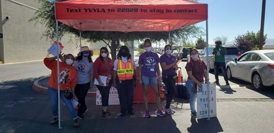 """YVYLA and IEHP Team Members greet attendees at a """"Pull-up and Pick-Up"""" backpack distribution event at IEHP's Victorville CRC in August 2020."""
